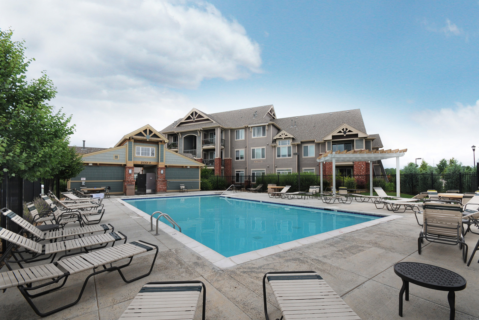 Amenities include a community pool and poolhouse