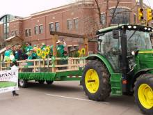 Bucking Horse St. Patrick's Day parade float being pulled by the tractor