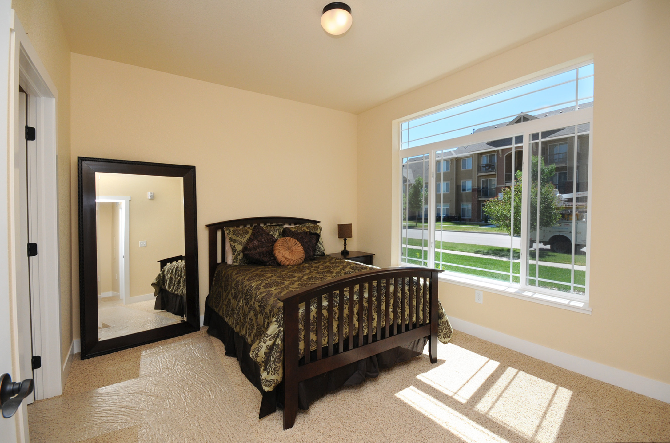 An airy master bedroom complements the entire condo