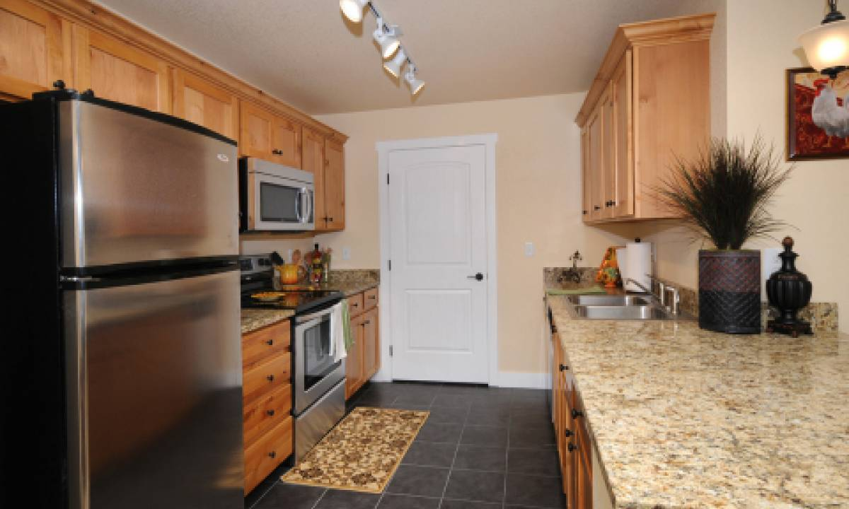Kitchens also feature stainless steel appliances and granite slab countertops