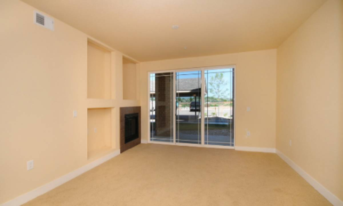 Spacious living rooms with large windows provide lots of natural lighting